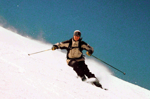 Skier carving a turn