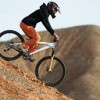 Girl downhill on bike