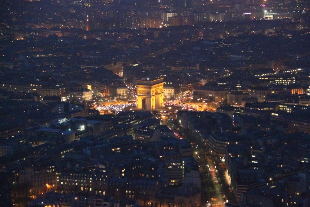 L'Arc de Triomphe by night, view form the Eiffel Tower